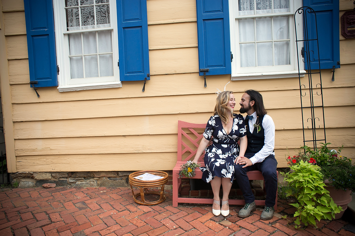 Engagement portraits in Annapolis, MD in front of old wooden house