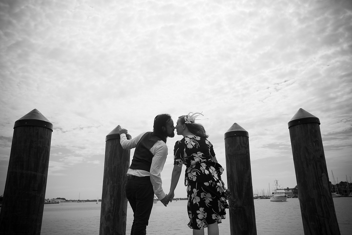 Engagement portraits in Annapolis, MD on the water and pier near pilings