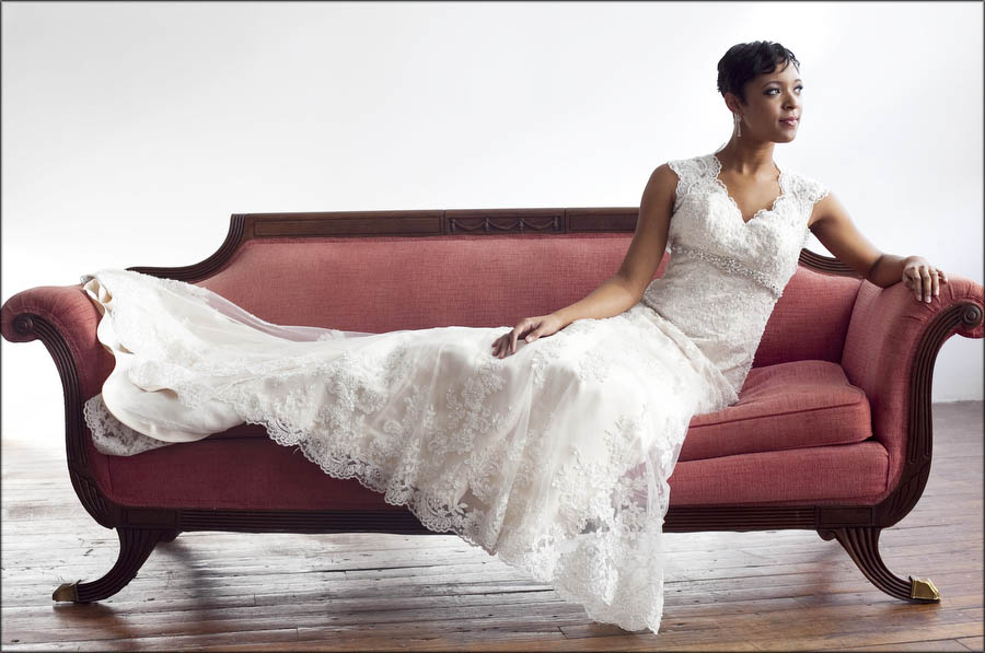 portraits of a bride on a couch in the studio