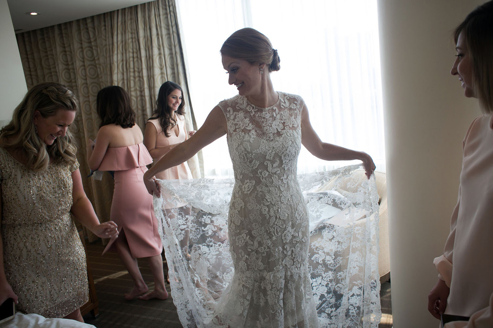 bride getting ready at the four seasons in baltimore