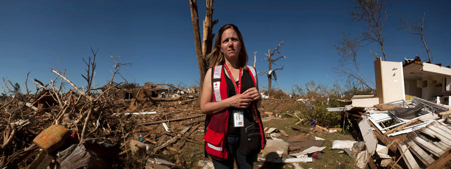 Panorama of hurricane damage in Tuscaloosa alabmaba with Red Cross worker