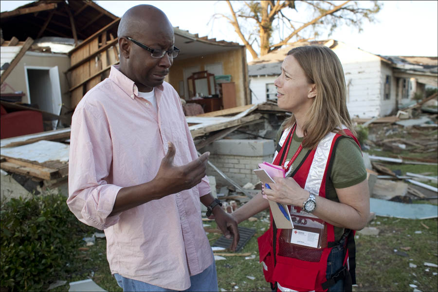 Lynette Nyman of the Red Cross with a victim of the Tuscaloosa hurricane