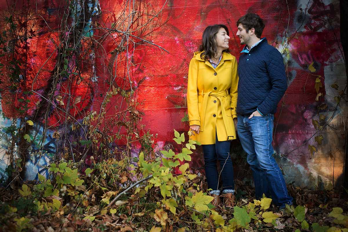 Engagement portaits with graffitti in Wyman Park, Baltimore