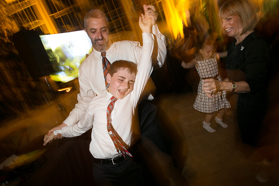 Father and son dancing at mitzvah in Baltimore