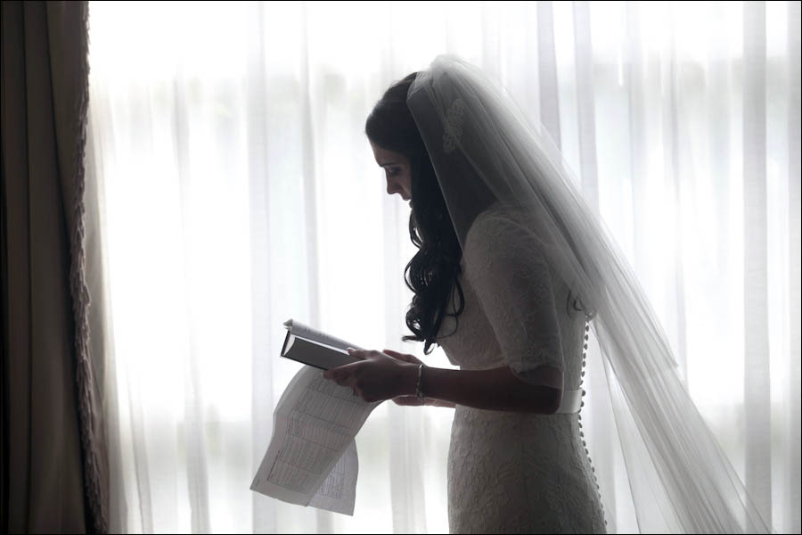 a bride does a prayer before her jewish orthodox wedding ceremony