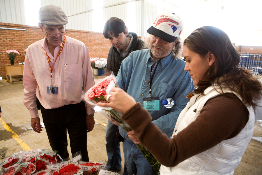 American buyers inspect flowers at a farm outside of Bogota.