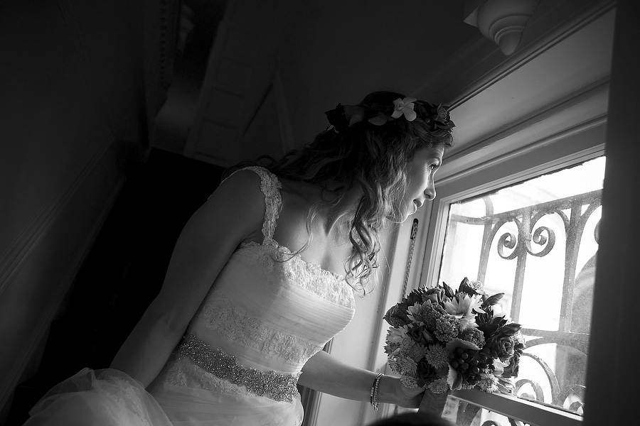 bride looks out windoqw