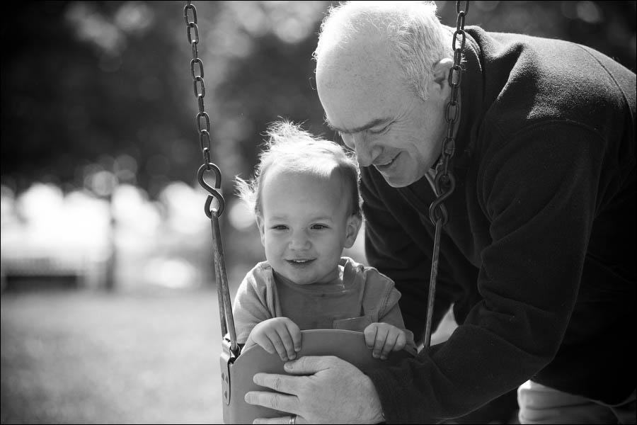 father and son casual photography on swing set