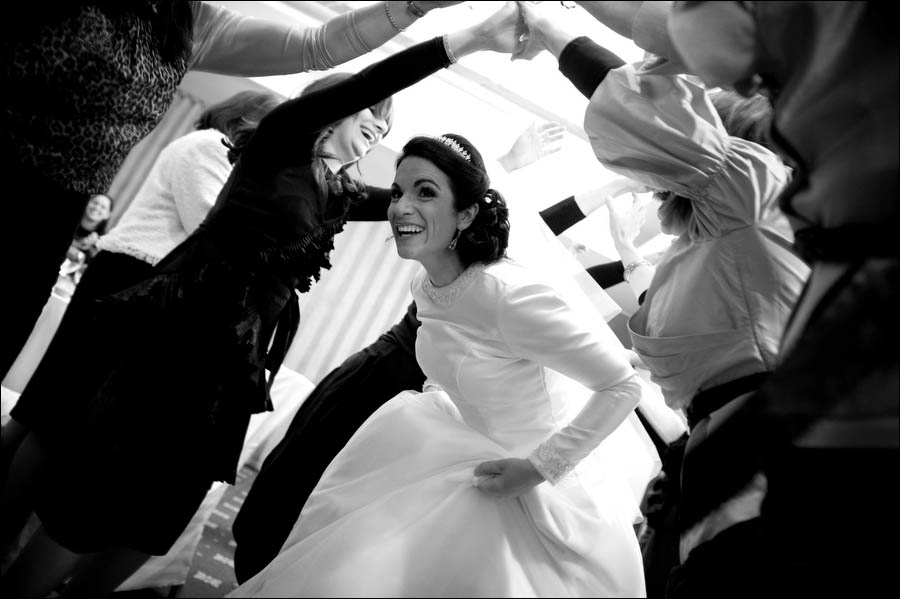 bride makes her entrance at  a jewish orthodox wedding