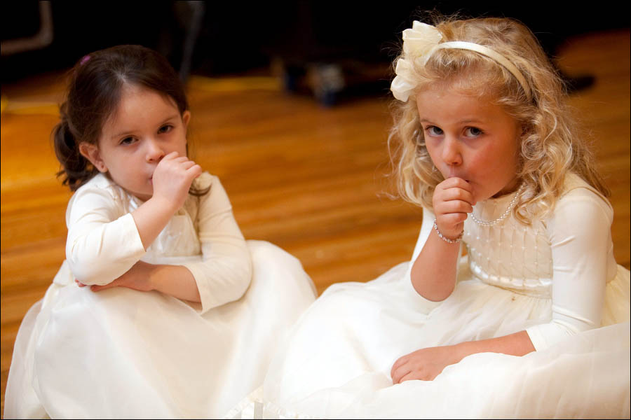 flower girls suck their thumbs at the end of a wedding