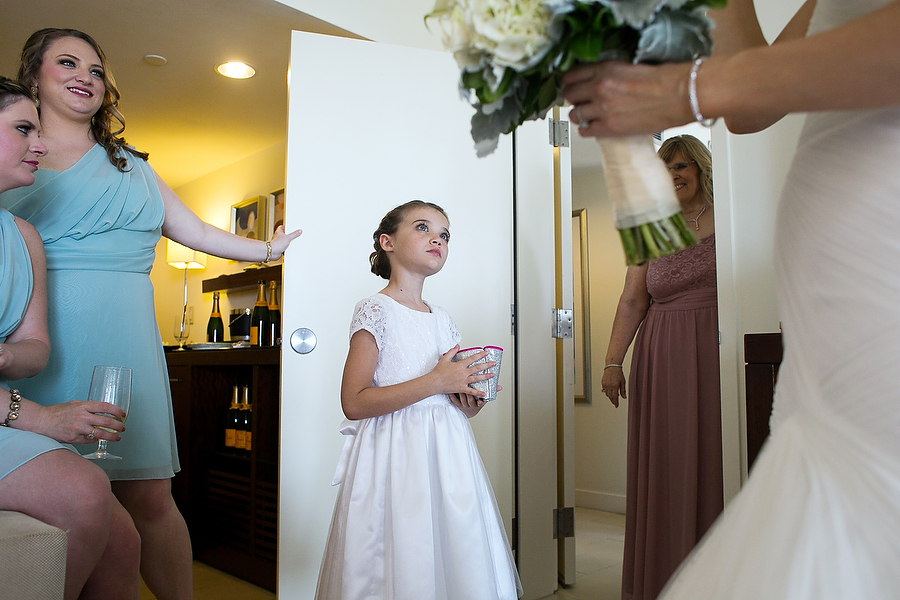flower girl looks at lindsay before her wedding at the casa marina in key west