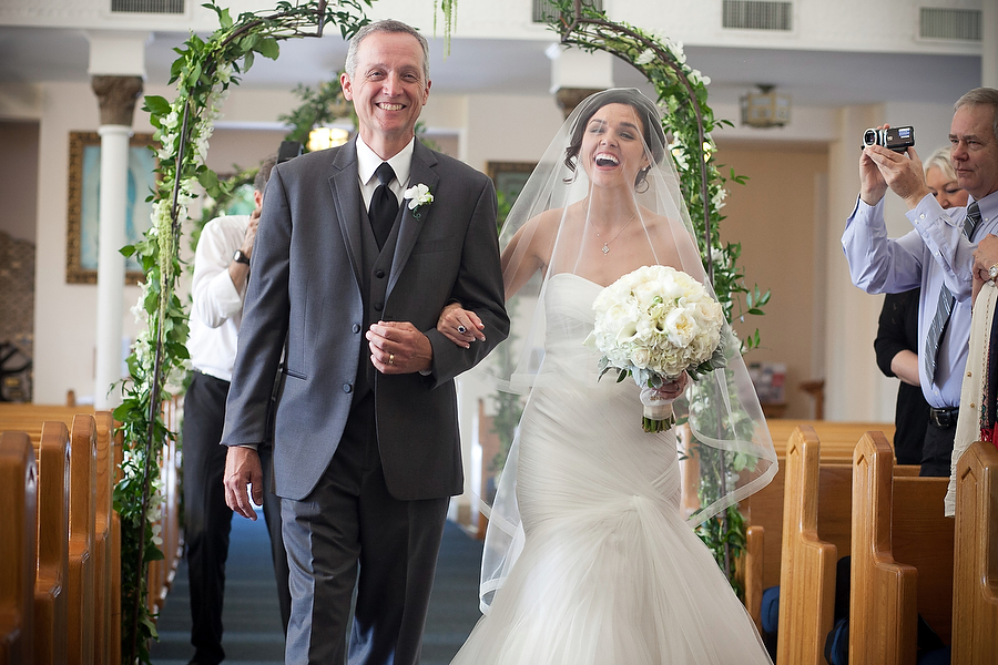 excited bride walks down the aisle at st marys church in key west