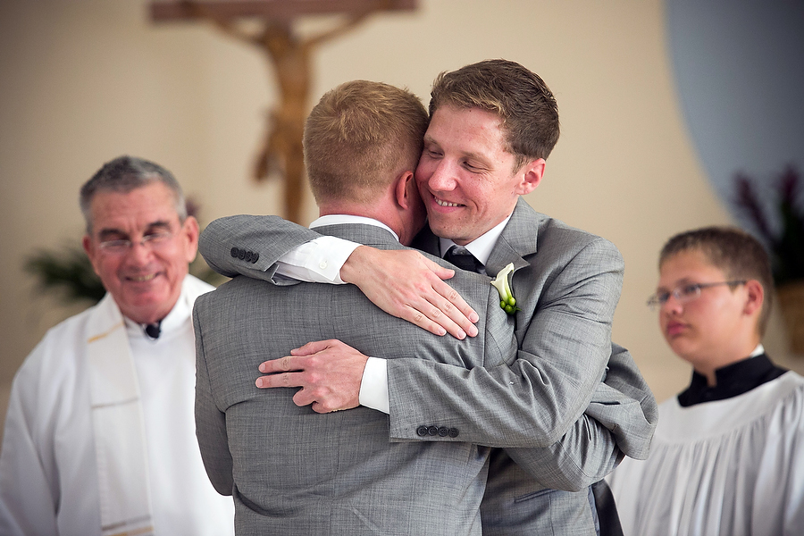grooms hugs his brother