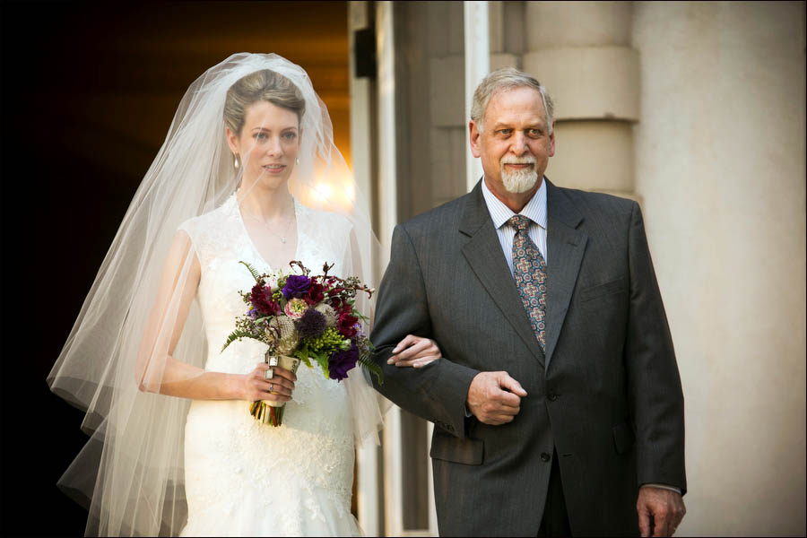 bride and her father walk down the aisle at an outdoor wedding at liriodendron