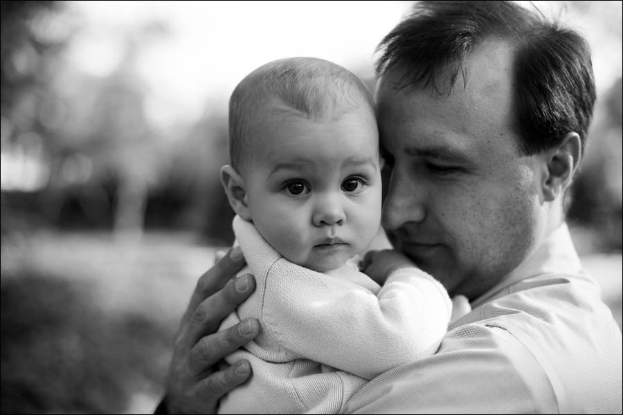 black and white photo of a father and his baby girl