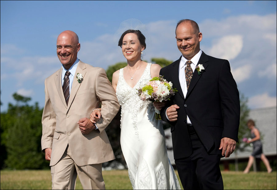 wendy walks down the aisle at her outdoor wedding at linganore wine cellars